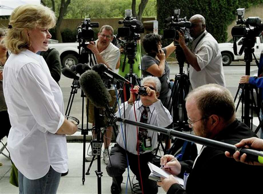 Investor Cassie Wilkinson talks about her financial losses after a guilty verdict was announced on all but one of 14 counts in the fraud trial of financier R. Allen Stanford Tuesday, March 6, 2012, in Houston. Stanford, a former Texas tycoon, whose financial empire once spanned the Americas, was convicted Tuesday for allegedly bilking investors out of more than $7 billion in a massive Ponzi scheme he operated for 20 years. (AP Photo/Pat Sullivan) Photo: Photo By Pat Sullivan / AP