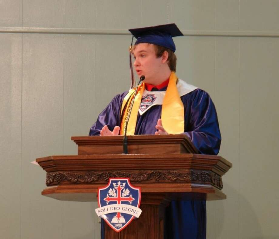 Jonathan Dobyns, Oak Ridge Christian Academy Class of 2013 valedictorian, speaks about his experience at the school during a graduation ceremony Saturday morning.