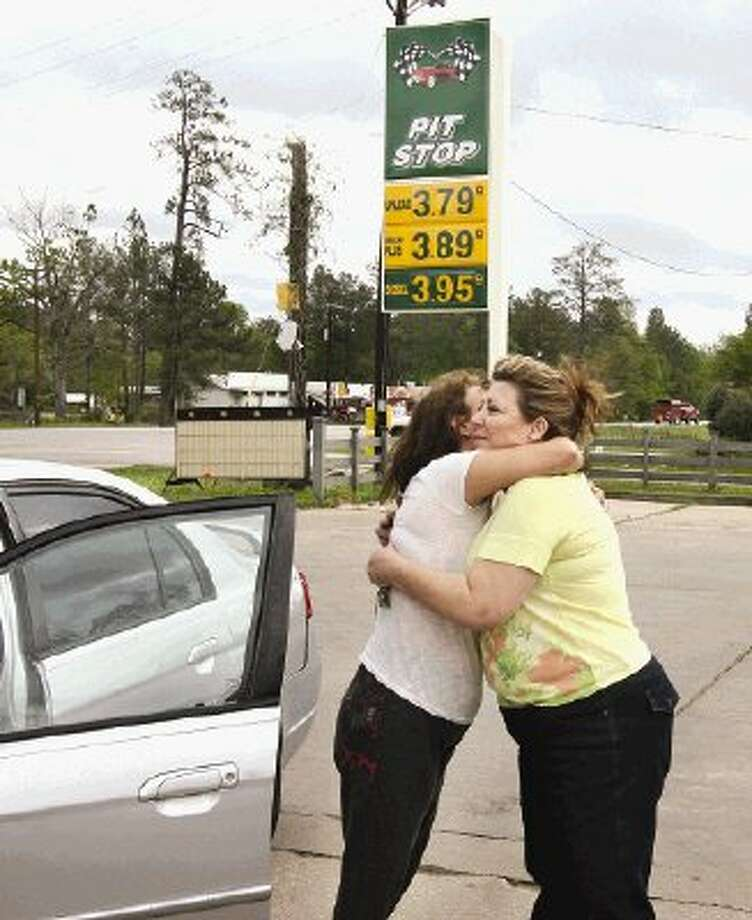 Longtime customer Diane Lopez, left, shares a tearful hug with Loretta Cartwright, whose family has closed down a trio of Pit Stop convenience store locations in and around Conroe after 27 years in business.