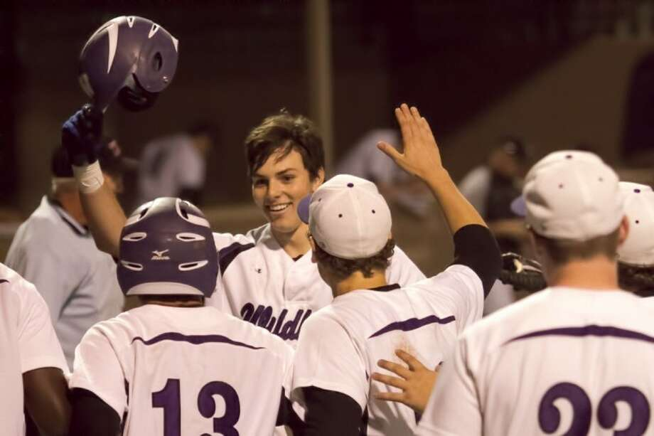 Willis' Holden Helmink crosses the plate after hitting a walkoff grand slam to give the Wildkats a 6-2 win over Kingwood Park in their District 18-4A opener. Photo: Billy Ballard
