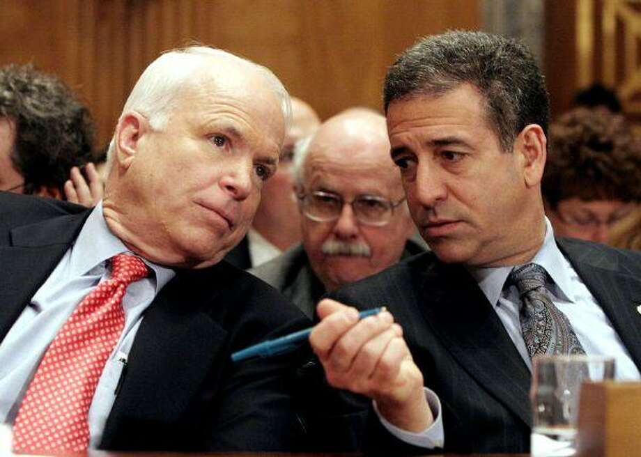 In this Jan. 25, 2006, file photo, Sen. John McCain, R-Ariz., left, chats with Sen. Russ Feingold, D-Wis. on Capitol Hill in Washington. The Supreme Court on Thursday threw out a 63-year-old law designed to restrain the influence of big business and unions on elections, ruling that corporations may spend as freely as they like to support or oppose candidates for president and Congress. The justices also struck down part of the landmark McCain-Feingold campaign finance bill that barred union- and corporate-paid issue ads in the closing days of election campaigns. / AP2006