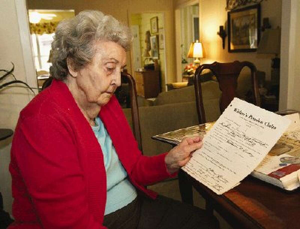 Floye Goodspeed looks over the official application for a Civil War pension made by her father in 1929.