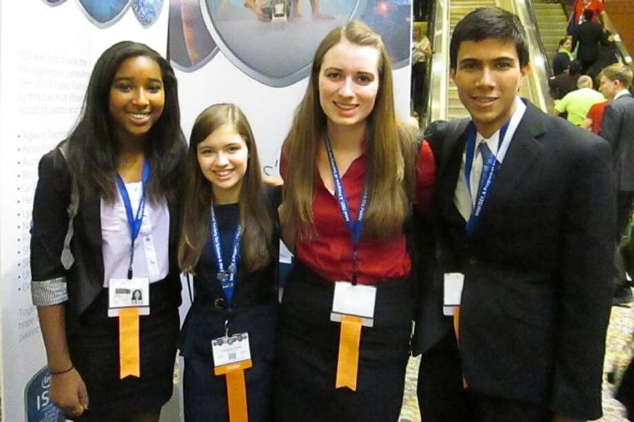 Students from the Academy of Science and Technology pose for a picture at Intel ISEF.