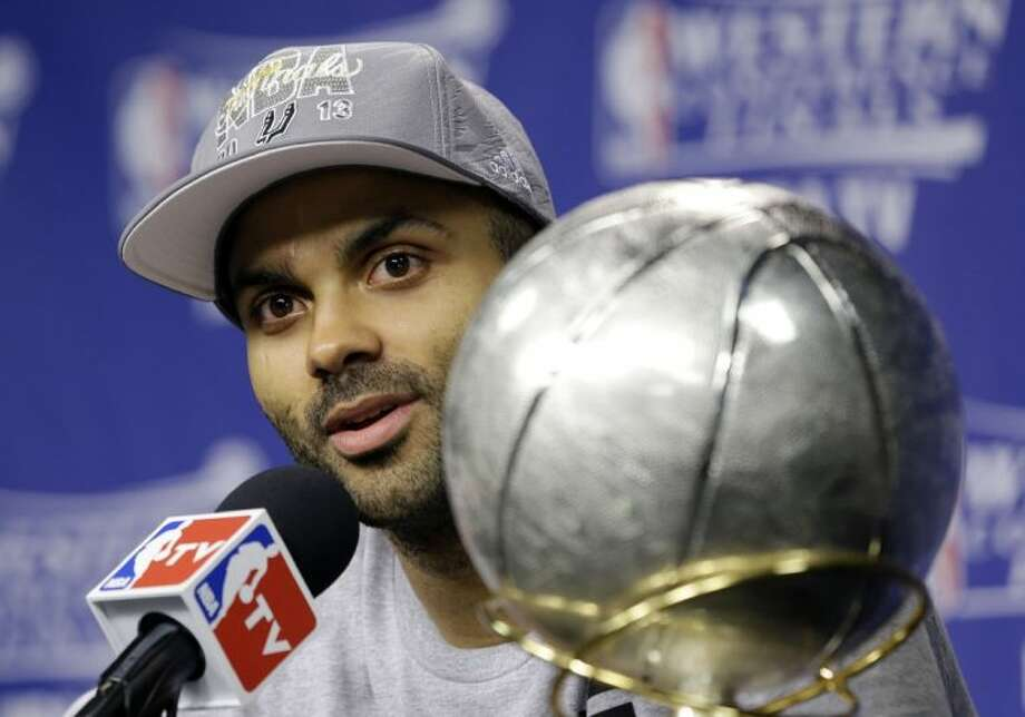 San Antonio Spurs guard Tony Parker speaks during a postgame news conference after the Spurs defeated the Memphis Grizzlies 93-86 in Game 4 of the Western Conference finals on Monday in Memphis, Tenn. Photo: Danny Johnston