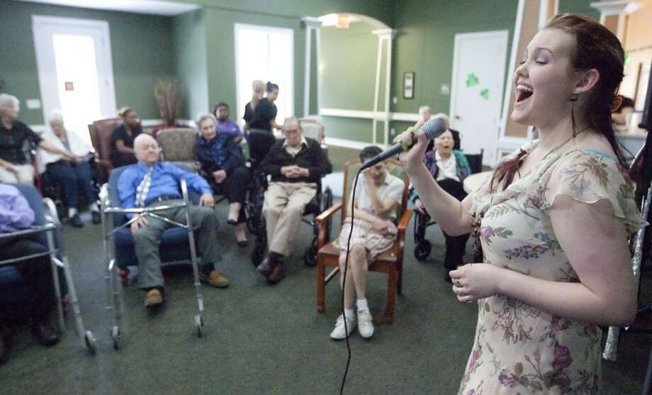 Cheyenne James, a former American Idol contestant, performs Sunday at Heritage Oaks Assisted Living and Memory Care Community in Conroe. Photo: Karl Anderson