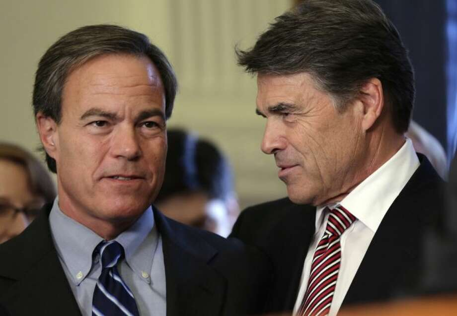 Gov. Rick Perry, right, talks with Speaker of the House Joe Straus, R-San Antonio, left, during a ceremonial signing of a water fund bill, Tuesday in Austin, Texas. The legislative session ended Monday, but Perry immediately called lawmakers back for a special session. Photo: Eric Gay