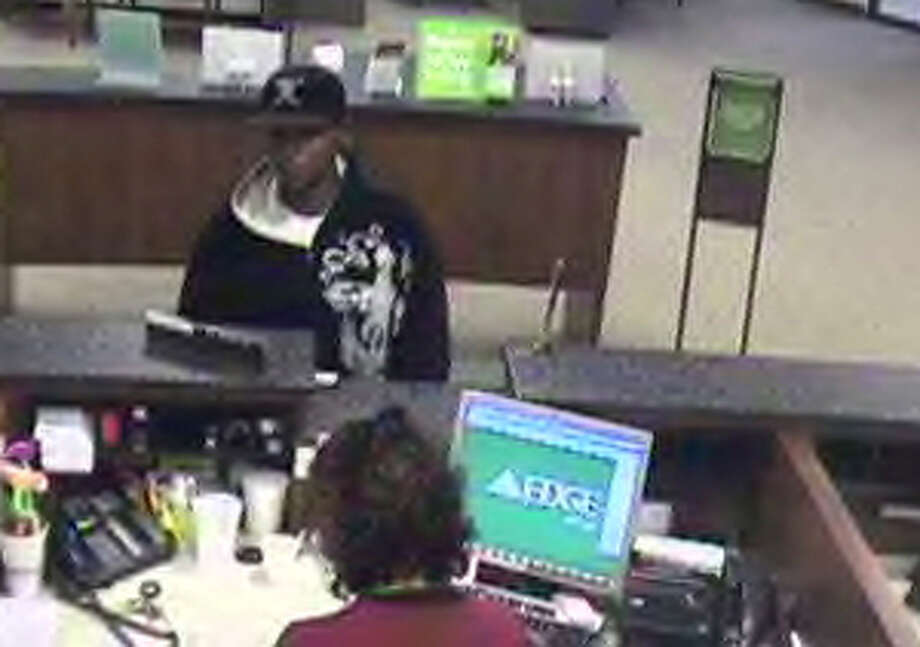 This video still from a surveillance camera was taken during the bank robbery at Regions Bank, located at 9480 College Park Drive in The Woodlands, around noon Tuesday. It was the third bank in The Woodlands robbed this year. The Traditions bank on 3205 College Park Drive was robbed Feb. 13. In both incidents, the robber is described as a black male wearing a black hoodie with embroidered designs across the left side and wearing a cap.
