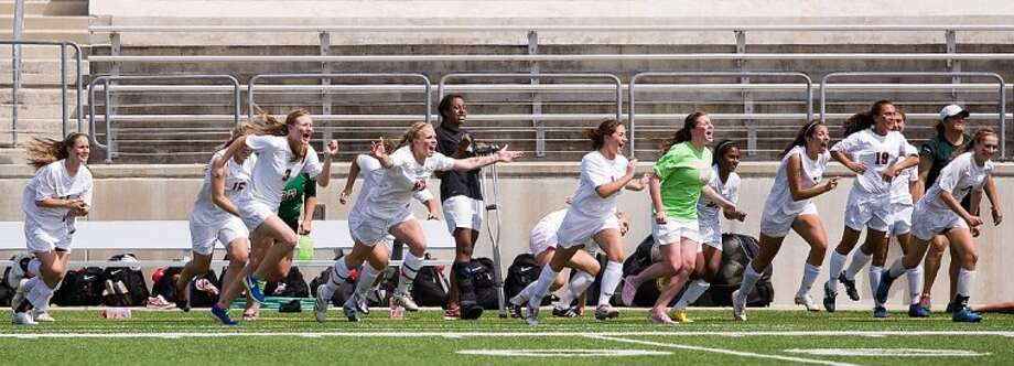 The Woodlands Lady Highlanders streamed on to the field after securing a 2-1 shootout victory over Garland Sachse in the Region II-5A semifinals Friday at the Kelly Reeves Athletic Complex in Austin.