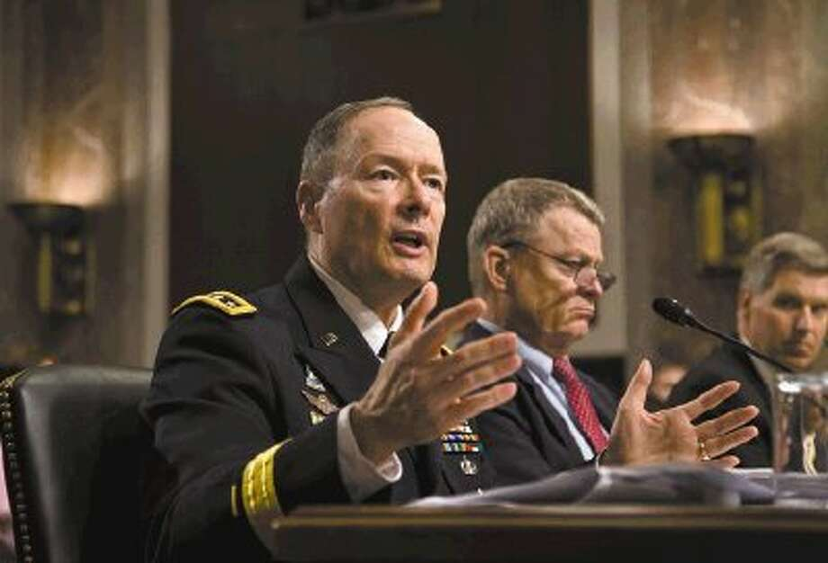 Gen. Keith B. Alexander, director of the National Security Agency and head of the U.S. Cyber Command, answers questions from lawmakers on Capitol Hill in Washington, Wednesday, during a Senate Appropriations Committee hearing. Photo: J. Scott Applewhite / AP2013