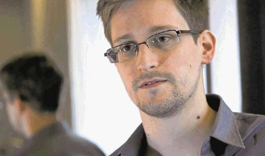 This photo provided by The Guardian Newspaper in London shows Edward Snowden, who worked as a contract employee at the National Security Agency, on Sunday, June 9, 2013, in Hong Kong. The Guardian identified Snowden as a source for its reports on intelligence programs after he asked the newspaper to do so on Sunday. (AP Photo/The Guardian) Photo: HONS / @WireImgId=2631268