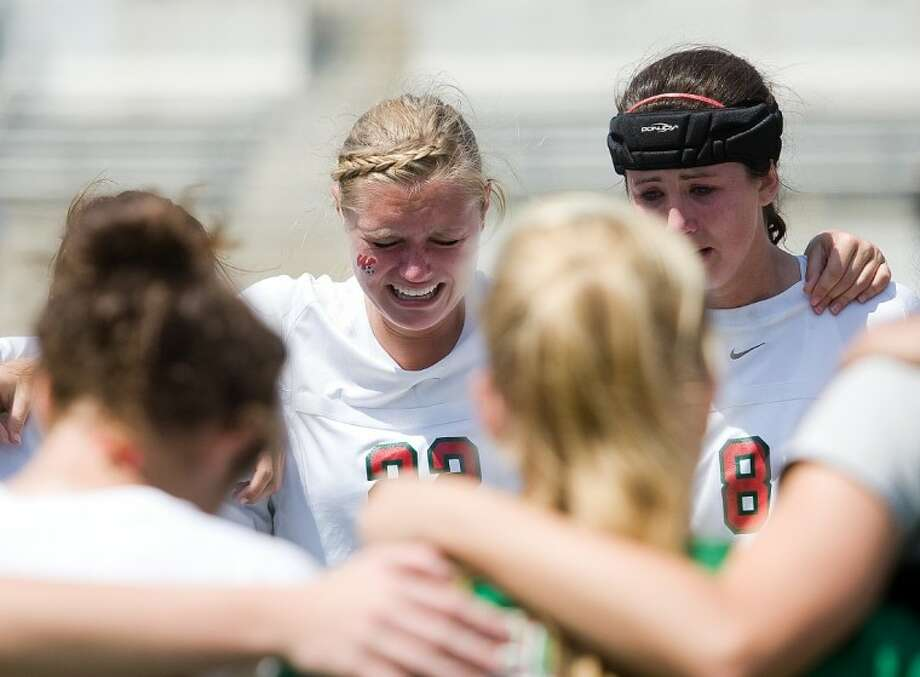 The Woodlands senior defenders Katie Kratkiewicz, left, and Claire Watson react after the Lady Highlanders' 1-0 loss to McKinney Boyd on Saturday in the Region II-5A final at the Kelly Reeves Athletic Complex in Austin.