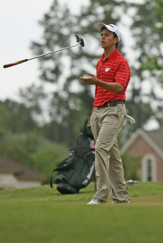 The Woodlands' Fernando Cruz flips his putter after putting on the 10th hole during Thursday's District 14-5A boys tournament at Oakhurst Golf Club in Porter.