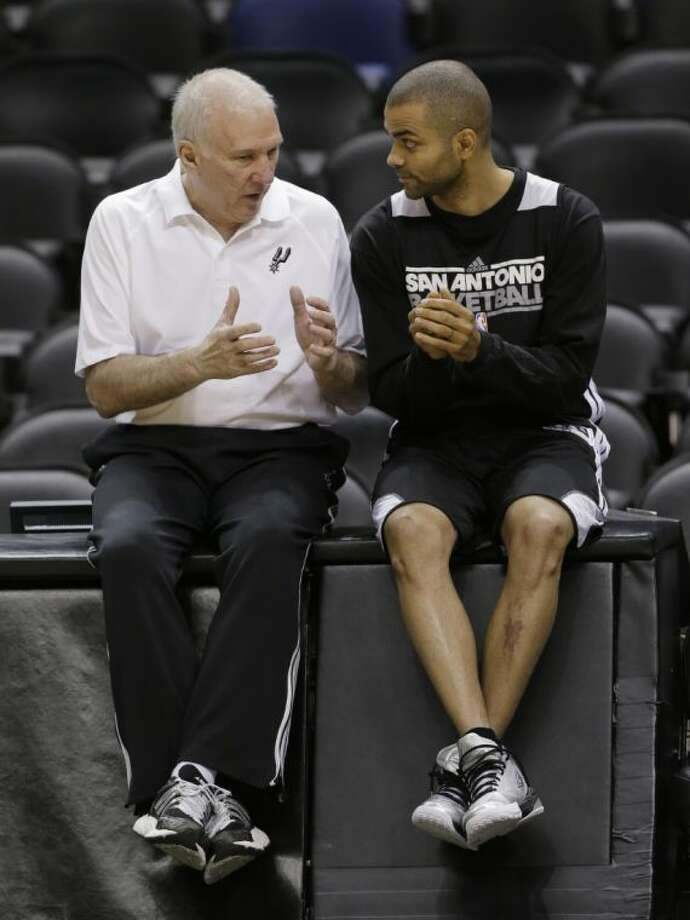 San Antonio Spurs coach Gregg Popovich and guard Tony Parker converse during practice Wednesday. Photo: Eric Gay