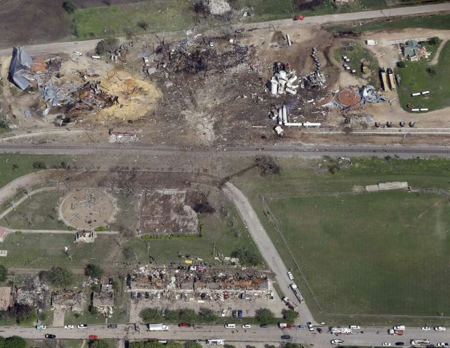 This April 18 aerial photo shows a destroyed fertilizer plant, top, following an explosion in West. The Federal Emergency Management Agency is refusing to provide money to help rebuild West, the small Texas town where a deadly fertilizer plant explosion leveled numerous homes and a school, and killed 15 people. Photo: Tony Gutierrez