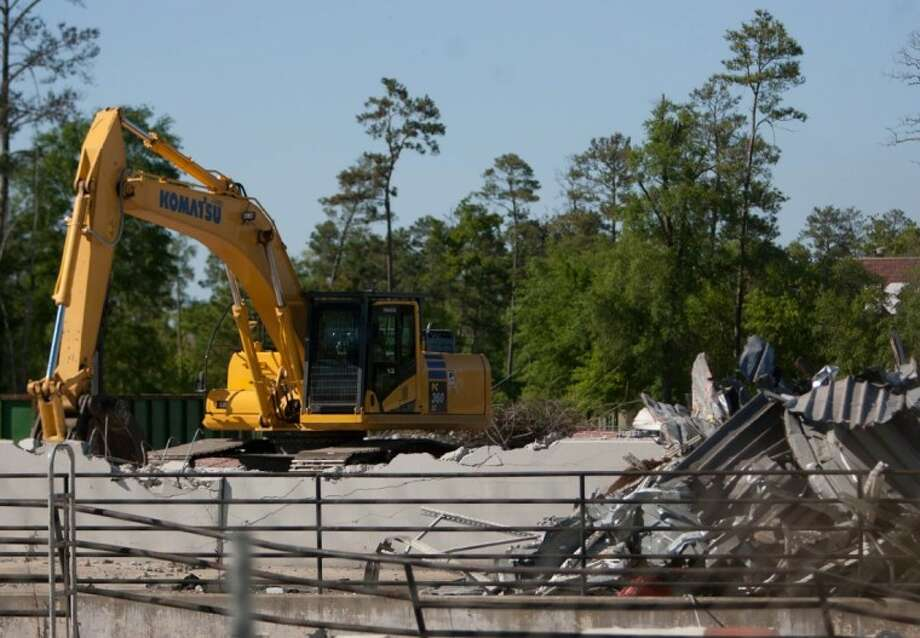 An excavator is seen amongst rubble of what remains of Garden Ridge on Texas 242 and Interstate 45 in The Woodlands on Friday. The store was the site of a large commercial fire earlier in the year. Photo: Staff Photo By Eric S. Swist