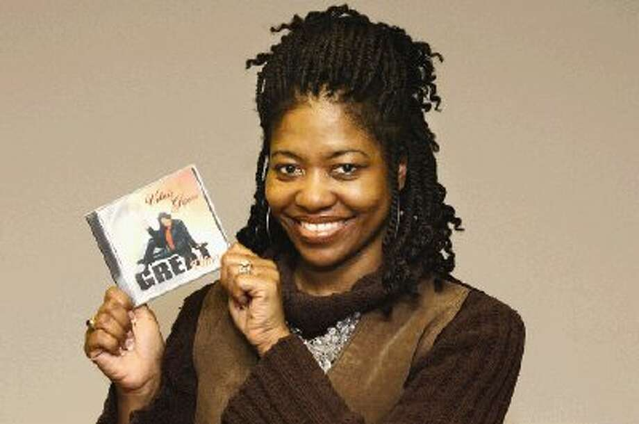 """Conroe gospel singer and """"Sunday Best"""" reality television show contest Valerie Gipson holds up her 2005 CD """"Great Things."""""""