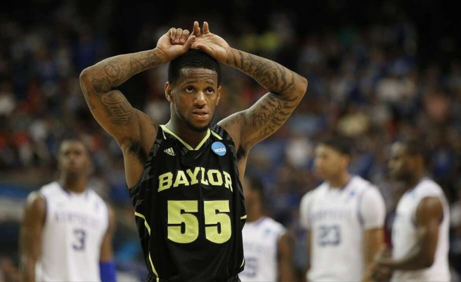 Baylor's Pierre Jackson walks off the court in the closing seconds of the second half of an NCAA tournament South Regional finals college basketball game against Kentucky, Sunday in Atlanta. Photo: John Bazemore