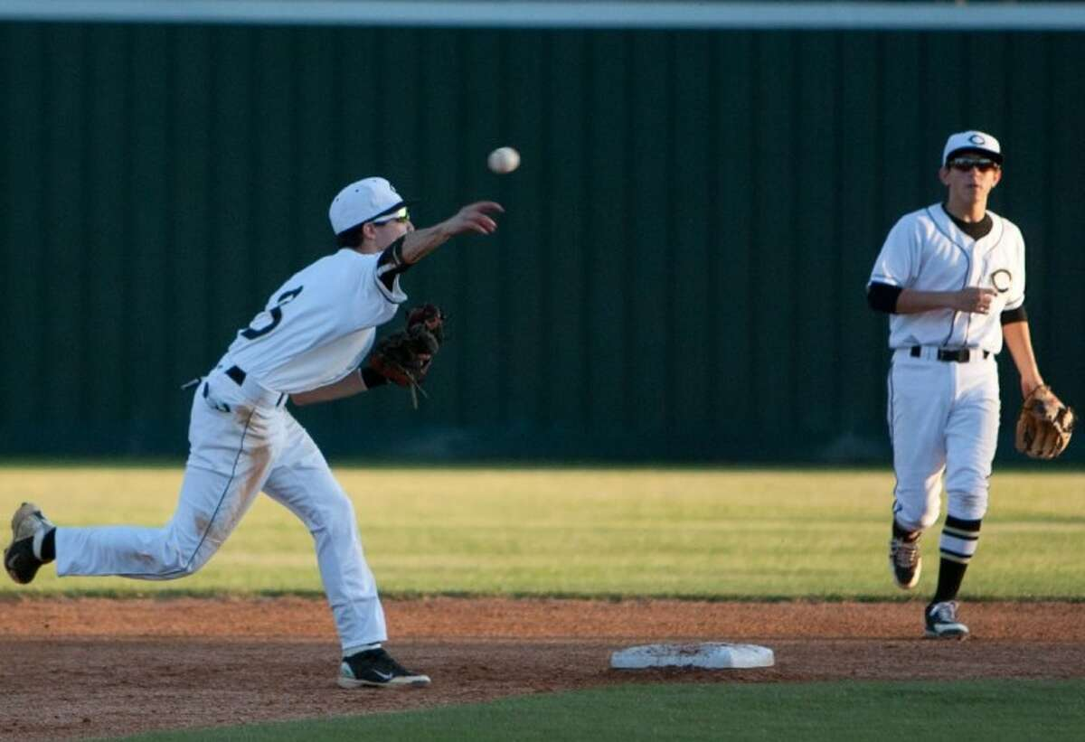 Conroe's Connor Ontivereros fires the ball to first base during Friday night's district game against College Park in Conroe.
