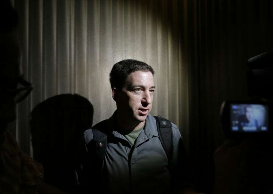 Glenn Greenwald, a reporter of The Guardian, speaks to reporters at his hotel in Hong Kong Monday. Greenwald reported a 29-year-old contractor who claims to have worked at the National Security Agency and the CIA allowed himself to be revealed Sunday as the source of disclosures about the U.S. government's secret surveillance programs, risking prosecution by the U.S. government. Photo: Vincent Yu