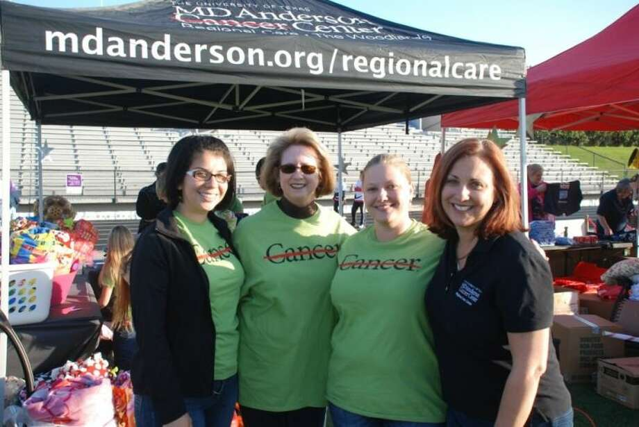 Physicians, staff and volunteers from the MD Anderson Regional Care Center in The Woodlands came out to Conroe High School May 3 to support and encourage local cancer survivors at the 2013 Relay For Life of Conroe. Pictured, from left to right, are: Iris Escobar, Kathryn Boynton, Jennifer McCollum and Dr. Pamela Schlembach. At this year's event, 59 teams and 742 participants raised more than $112,000.