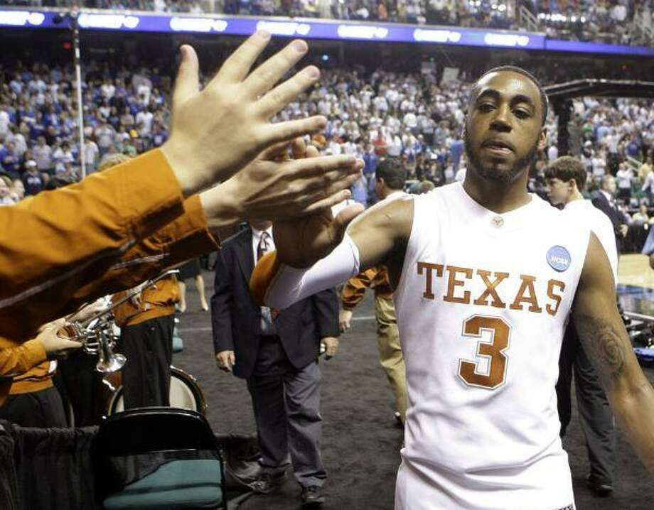 Texas' A.J. Abrams high-fives fans after the Longhorns 76-62 win over Minnesota in a first-round men's NCAA college basketball tournament game in Greensboro, N.C., Thursday. / AP