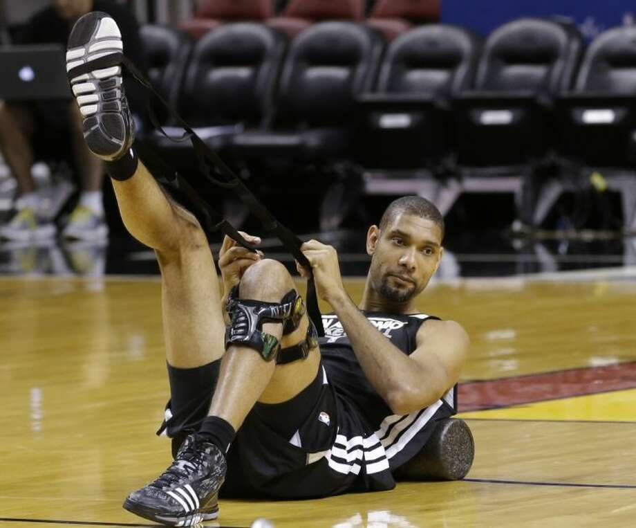 San Antonio Spurs forward Tim Duncan stretches during practice on Wednesday at the American Airlines Arena in Miami. The Spurs take on the Miami Heat in Game 7 of the NBA Finals on Thursday in Miami. Photo: Wilfredo Lee