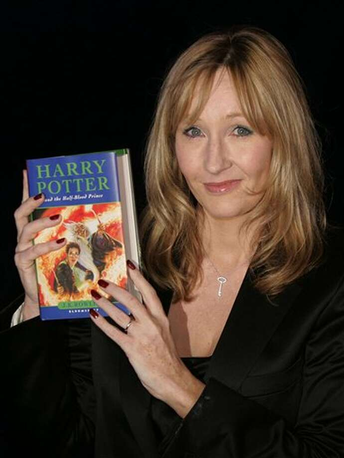 FILE -- In this Friday, July 15, 2005 file photo shows British author J.K. Rowling holding a copy of her latest book 'Harry Potter and the Half-Blood Prince' as she arrives at Edinburgh Castle in Edinburgh, Scotland, for its world wide launch. At last, Harry Potter's adventures are available electronically. The seven novels about J.K. Rowling's boy wizard are for sale as e-books and audio books on the author's Pottermore website, the site's creators announced Tuesday March 27, 2012. The books are available only through the website, which says they are compatible with major electronic e-readers, including Amazon's Kindle and Sony's Reader, as well as with tablets and mobile phones. (AP Photo/Matt Dunham, File) Photo: Photo By MATT DUNHAM / AP
