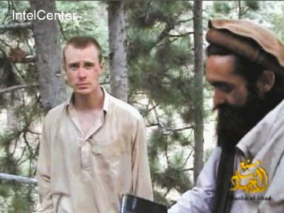 This file image provided by IntelCenter on Wednesday Dec. 8, 2010 shows a frame grab from a video released by the Taliban containing footage of a man believed to be Bowe Bergdahl, left. Photo: Uncredited / AP2013