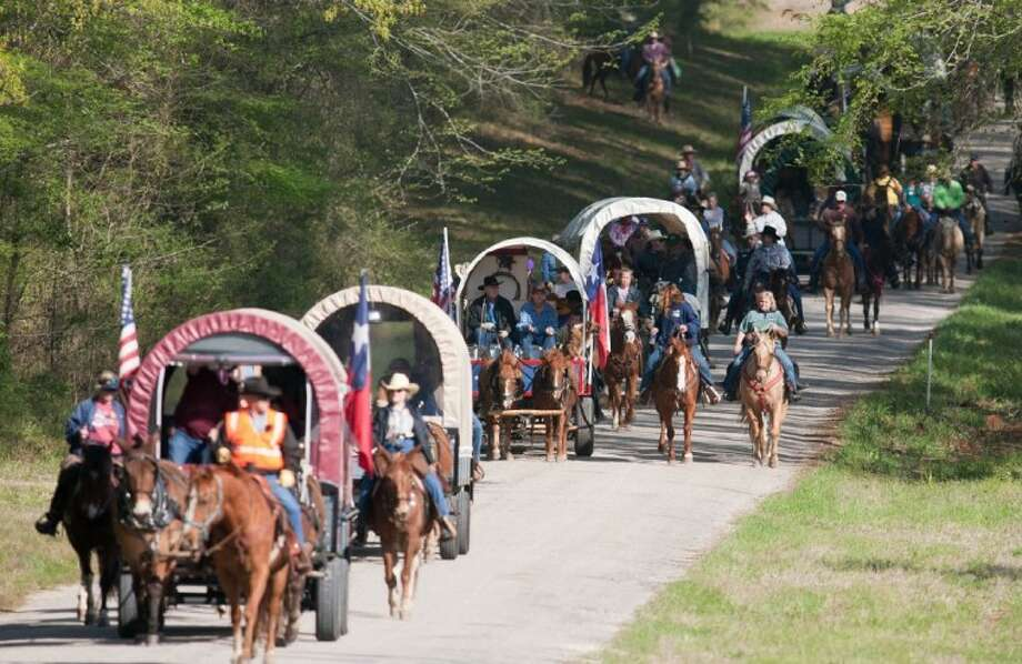 Trail riders take part in the 18th Annual Montgomery Fair & Rodeo Scholarship Trail Ride in 2010 through Sam Houston National Forest in Huntsville. An estimated 17 wagons and nearly 300 riders took part in this year's ride. The 2011 Trail Ride was March 26-27.