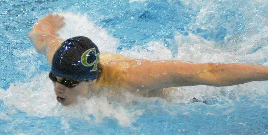 College Park's Gray Umbach broke the 200 IM record at the District 14-5A championships at the CISD Natatorium Saturday