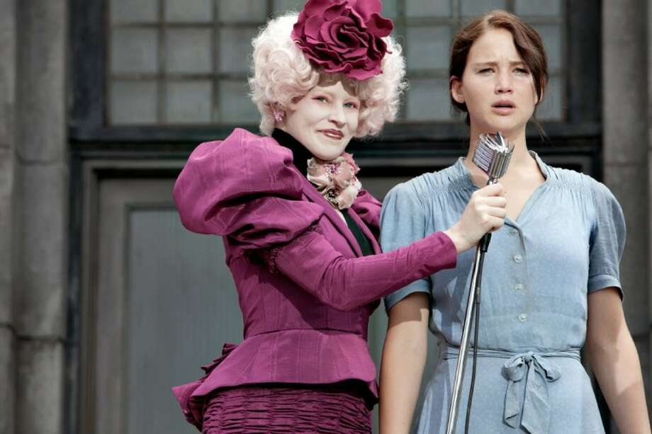 "In this image released by Lionsgate, Elizabeth Banks portrays Effie Trinket, left, and Jennifer Lawrence portrays Katniss Everdeen in a scene from ""The Hunger Games."" Photo: Murray Close"