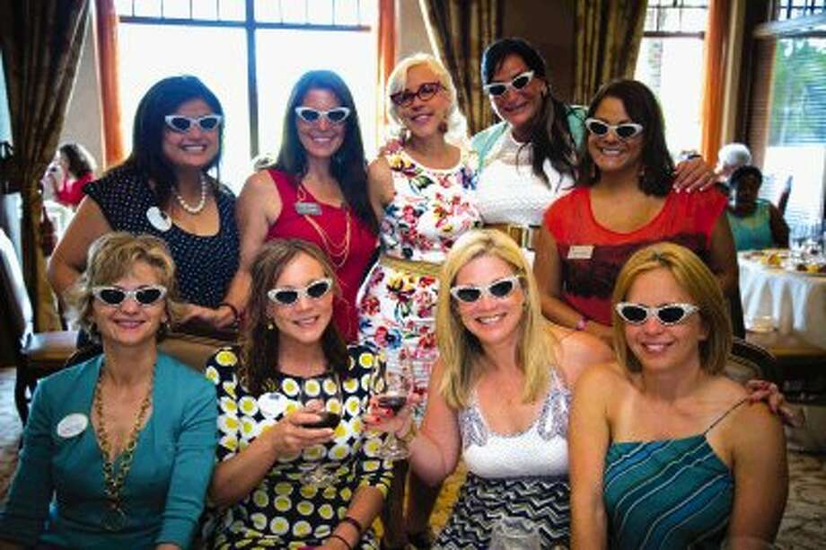 "The gals donned their most ""rad"" white sunglasses at the Ladies of the Vine luncheon during the recent Wine & Food Week. The event featured celebrity chef, Emily Ellyn, top row center and carried the theme of ""retro rad."" Photo: Steven David / Houston Event Photos"