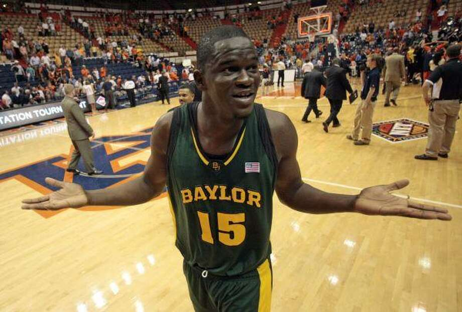 Baylor's Mamadou Diene reacts at the end of a 74-72 win over Auburn in their NIT third-round college basketball game at the Beard-Eaves Memorial Coliseum in Auburn, Ala., Tuesday. / FR159046 AP