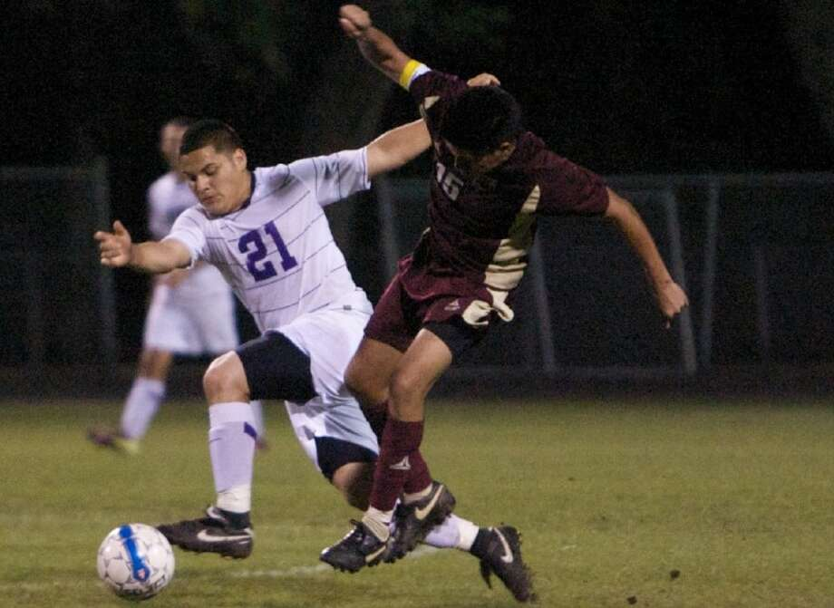 Montgomery's Jimmy Estrada battles past a Magnolia West player during Friday night's game in Montgomery. Photo: Staff Photo By Eric S. Swist