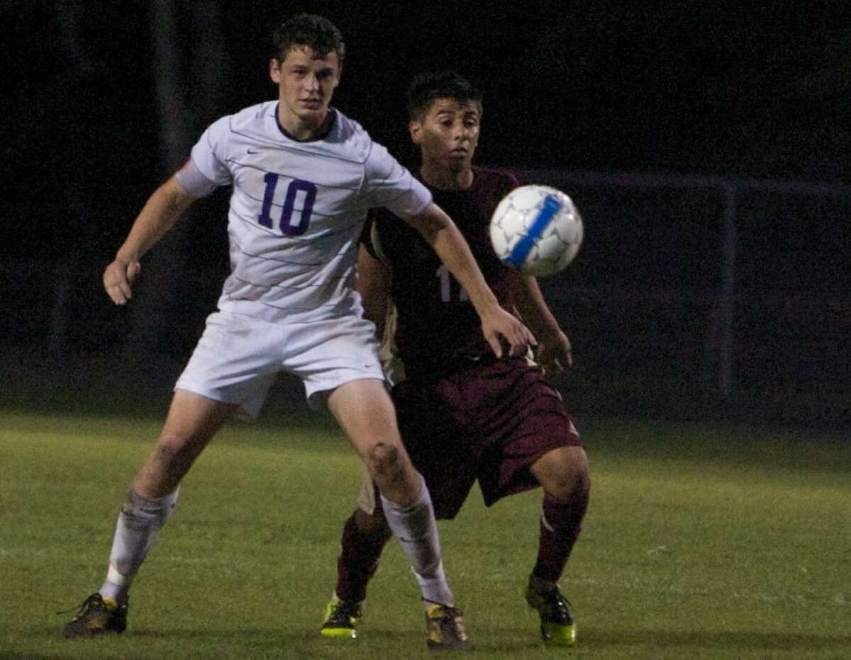 Montgomery's Cameron Gearing eyes the ball during Friday night's game against Magnolia West in Montgomery.