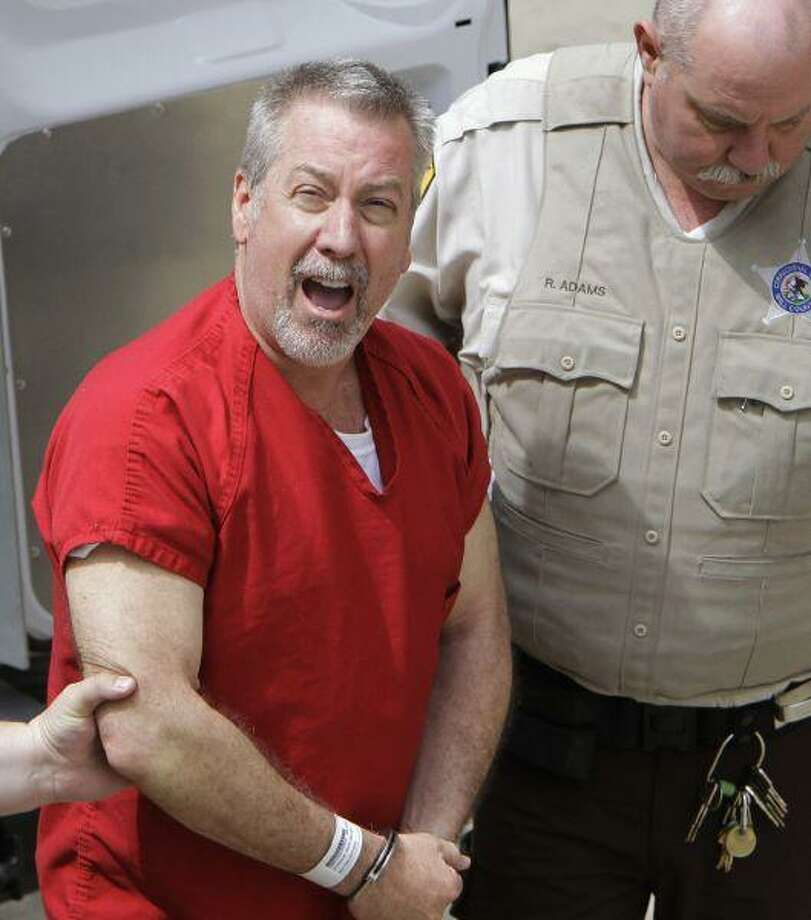 In this May 8, 2009 file photo, former Bolingbrook, Ill., police sergeant Drew Peterson yells to reporters as he arrives at the Will County Courthouse in Joliet, Ill. / AP2009