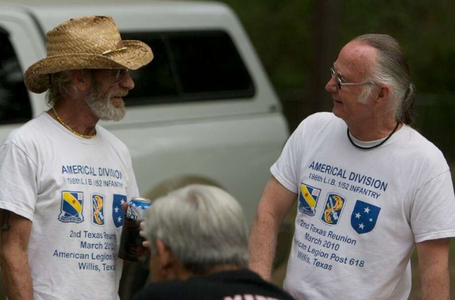 Vietnam veteran Roger Meeker, left, of Oklahoma, and Dan Gagen, of California, share a laugh during Friday's reunion for members of the 1-52nd Infantry Battalion at the American Legion Post 618 in Willis. Photo: Staff Photo By Eric S. Swist