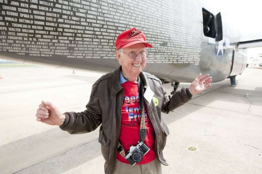 Walter White shows his excitement after riding on a B-24 from Ellington Field during the Wings of Freedom Tour Friday at Lone Star Executive Airport in Conroe. Photo: Karl Anderson