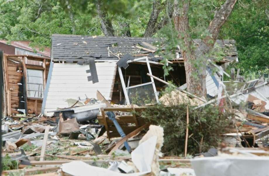 The remnants of an early morning home explosion are seen June 11 in Dobbin, Texas. Photo: Eric S. Swist