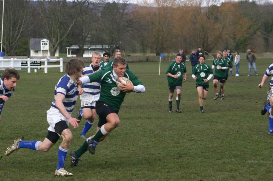 The Woodlands Youth Rugby Club's Jordan Allan runs with the ball during the team's spring break trip to Scotland.