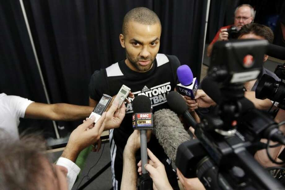 San Antonio Spurs guard Tony Parker speaks to reporters. Game 5 of the NBA Finals is tonight. Photo: David J. Phillip