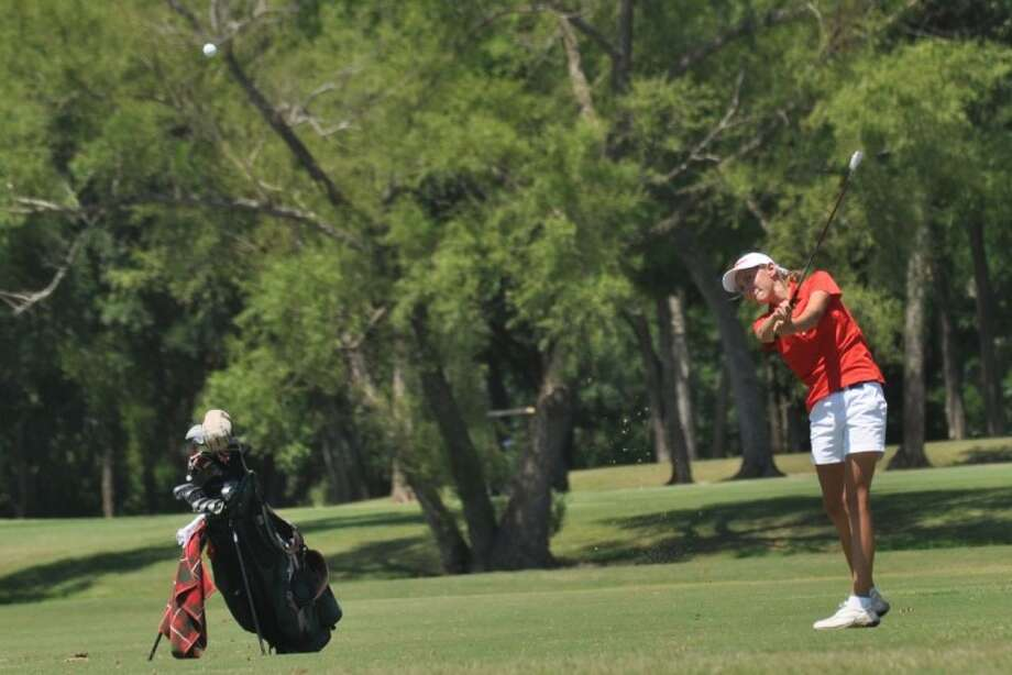 The Woodlands' Nicole Budnik watches a shot during last year's UIL State Golf Championships at Jimmy Clay Golf Course in Austin. Photo: Keith MacPherson