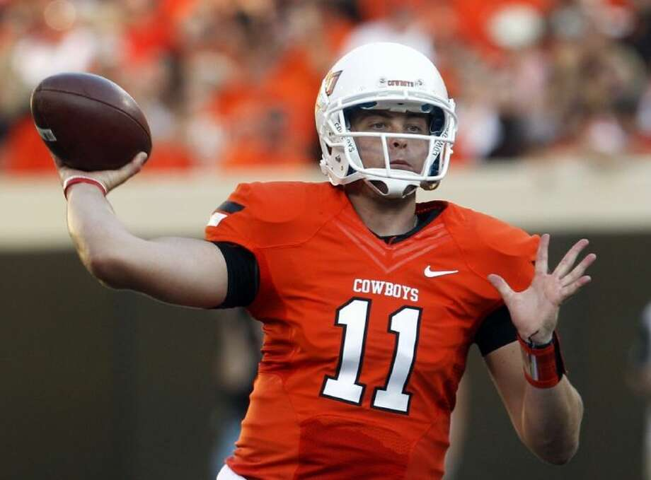 Wes Lunt started five games as Oklahoma State's quarterback last season. He is headed to the University of Illinois. Photo: Sue Ogrocki