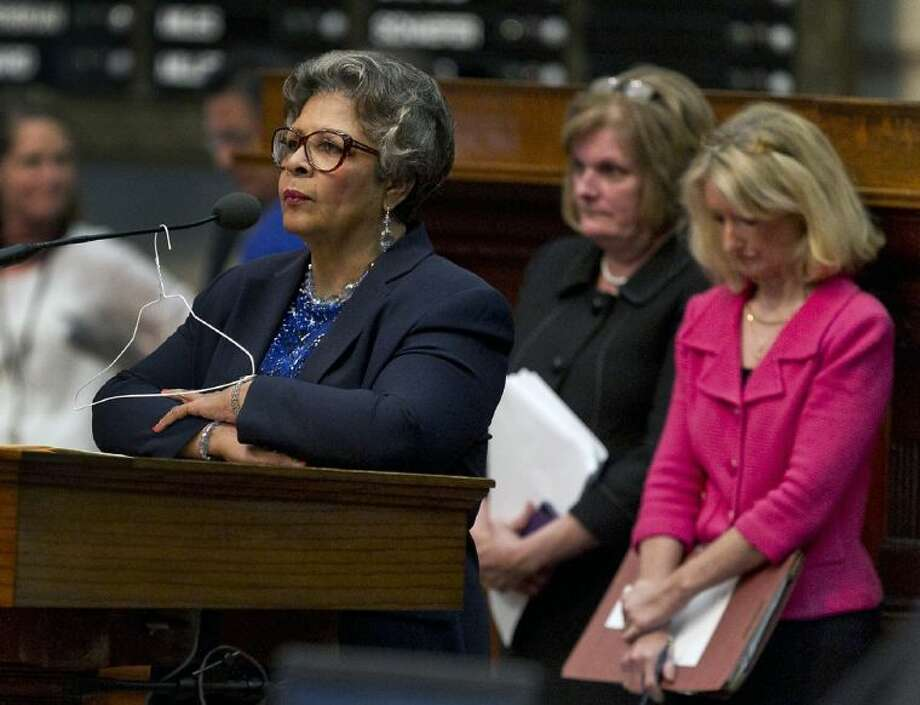 Rep. Senfronia Thompson, D-Houston, stands at the podium where she has hung a hanger from the microphone on the House floor as she attempts to add an amendment to create an exception for victims of rape and incest in Senate Bill 5 during debate at the State Capitol in Austin, Texas, on Sunday. Photo: Rodolfo Gonzalez
