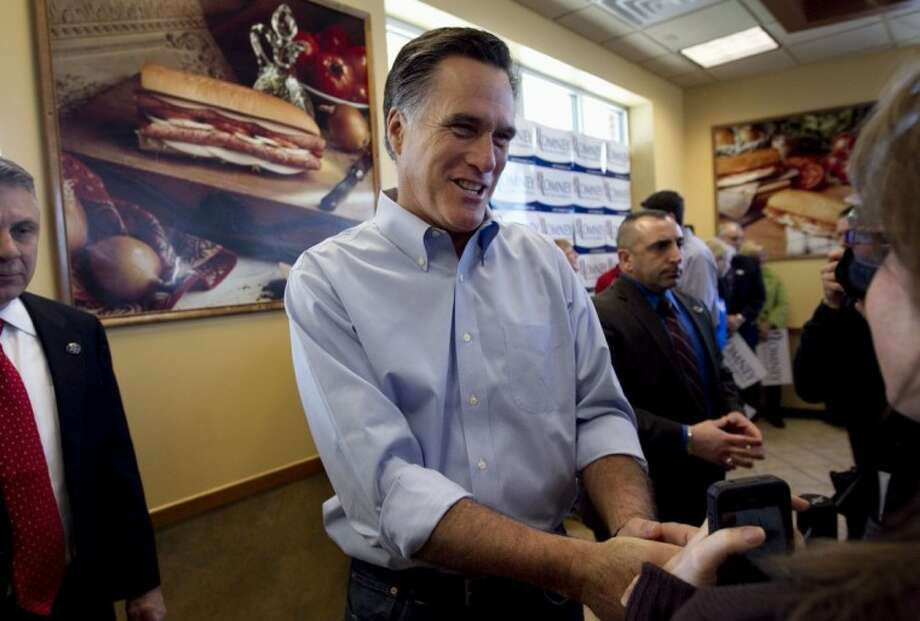 Republican presidential candidate and former Massachusetts Gov. Mitt Romney greets people during a campaign stop at a Cousins Subs fast food restaurant in Waukesha, Wis., Tuesday. Photo: Steven Senne