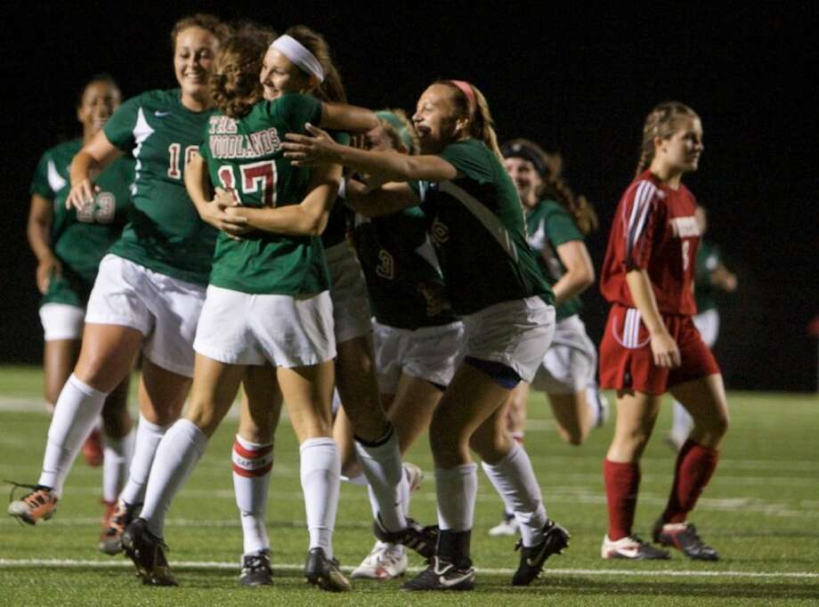 The Woodlands' Carmen Webster celebrates a goal with teammates during Tuesday night's playoff game against Tomball at Woodforest Bank Stadium in Shenandoah.