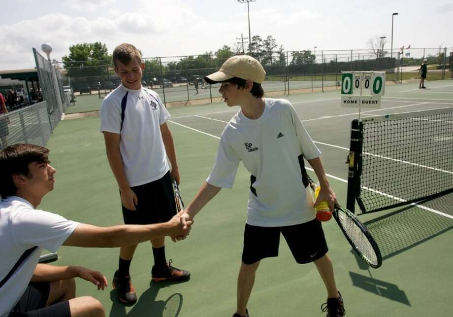 Willis' Michael Mckenery, left, and Justin Goodall shake hands with Kingwood Park's Joshua Thompson before the start of their doubles match during Wednesday's District 18-4A tournament at the Blythe Calfee Tennis Center in Willis. Photo: Staff Photo By Eric S. Swist
