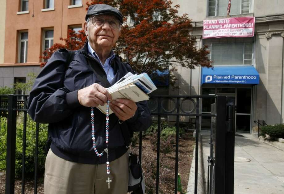 With anti-abortion flyers and rosary in hand, Richard Retta, 80, waits for people to approach Planned Parenthood in downtown Washington Wednesday. Three days a week, for the past eight years, Retta has stood outside a Planned Parenthood clinic in downtown Washington, three blocks from the White House, and tried to convince women not to get abortions. Photo: AP Photo By Jacquelyn Martin