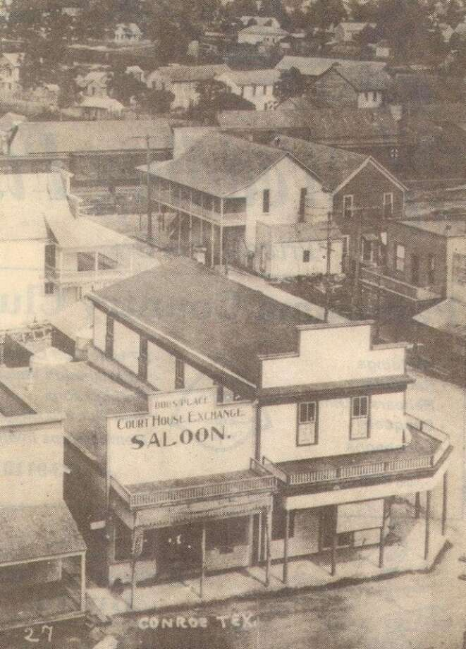 The original wooden building that Pete West owned circa 1910 is below. It was on the corner of Chambers (now Main Street) and Simonton facing the courthouse. The structure burned in the February 1911 fire that destroyed much of downtown Conroe. Pete West promptly rebuilt today's brick building on the same site in 1912.