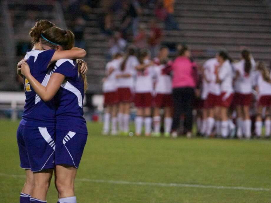 Montgomery's Torry Labaume, left, and Paige Smith embrace after the Lady Bears' 3-1 loss to Lumberton in the Region III-4A sectionals on Thursday night at Don Ford Stadium in New Caney. Photo: Staff Photo By Eric S. Swist